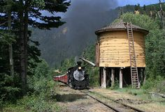 Cumbres & Toltec Scenic Railroad narrow-gauge steam engine near water tower. Chama, New Mexico