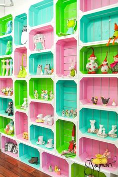 Bright painted crate shelves - (no instructions but very doable - attached together and to the wall, then painted - so cute)