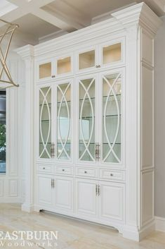 White china cabinet with decorative mullion panel doors and raised panel drawers decorated with Schuab hardware. White China Cabinets, Painted China Cabinets, Built In Cabinets, China Cabinets And Hutches, White Kitchen Cabinets, Kitchen Cabinetry, Dining Room Storage, Cabinet Design, Panel Doors