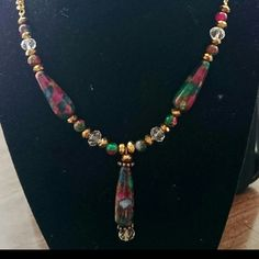 """Emerald, Ruby & Sapphire necklace Size: 17"""" Handmade Gold colored curb link necklace w/ 3 30x10mm Ruby Sapphire Emerald in Quartz w/ Pyrite Teardrop focal Beads. also in this necklace are emerald, ruby & sapphire quartz pyrite beads, clear crystal beads, & 6x4mm gold Swarovski crystals. To the best of my knowledge these stones are made from thin pieces of natural ruby, emerald, sapphire & then heat bonded to quartz. Wear w/ many colors & styles.  Would make a great gift idea!"""