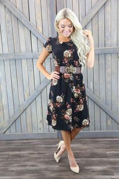 Cassie Dress in Black  This black floral dress looks great on all body shapes. The Cassie has cap sleeves and is gathered at the waist. Would look great with a belt.  100% Polyester Handwash cold, lay flat to dry.  Modest black floral dress, Modest Teacher dress