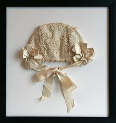 Antique hand crochet off white baby bonnet with silk off white ribbon tie