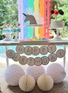 Rainbows and unicorns birthday party by the pool! See more party ideas at CatchMyParty.com!
