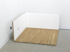Roman Ondak Untitled (Corner), 1997 Installation Section of parquet flooring, wooden panels, electric socket Overall dimensions 110 x 112 x 52 cm