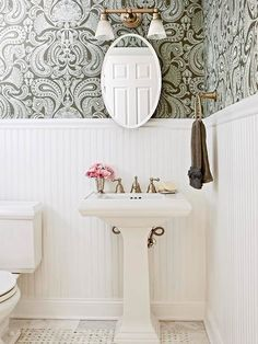 Half Bathroom with wallpaper and wainscoting