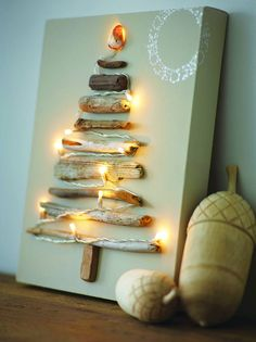 Driftwood Christmas Tree Make a Christmas tree canvas with driftwood and string lights. Christmas Tree Canvas, Driftwood Christmas Tree, Diy Christmas Tree, Christmas Lights, Christmas Holidays, Xmas Tree, Christmas Pictures, Simple Christmas, Christmas Paintings On Canvas