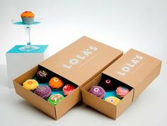 Creative Cupcake Packaging - love the use of a brightly coloured holder in the brown box.