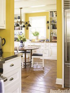 Retro Kitchen Kitchen designer Mick de Giulio created a homey kitchen with a retro feel in this Chicago house using yellow paint. The color, Benjamin Moore's Stuart Gold, unifies both rooms, but also gives both the kitchen and the dining area a burst of energy. The walnut floor, hand-scraped to give it even more character, changes to a chevron pattern in the adjoining breakfast room.