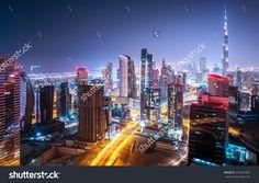 Beautiful night city, cityscape of Dubai, United Arab Emirates, modern futuristic architecture nighttime illumination, luxury traveling concept
