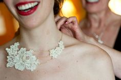 Honoring your parents: Mother of the bride's lace dress repurposed into bib-style necklace for bride's wedding | Photo: Melanie Maxwell