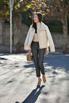 Pairing a faux shearling jacket with workwear staples like trousers and a sleek turtleneck sweater. Excited about wearing this jacket with a casual travel outfit too, like joggers (these would do!), sneakers (my current favorites here) and a cashmere sweater (this one is 40% off and I love the distressing). Happy Monday! *** Jacket (I sized …