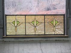 This is a cute, simple cottagey transom type of panel. It would be nice hanging in the upper part of a window or over a doorway.    It has a