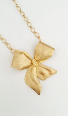 A personal favorite from my Etsy shop https://www.etsy.com/listing/607639293/gold-necklace-vintage-bow-brooch-with-a