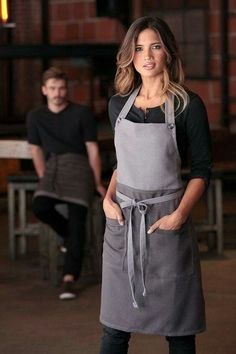 The Soho bib apron. The perfect combination of edgy fashion and forward-thinking functionality. Featuring a contrast color block, buttoned neck strap, reinforced stress points and two patch pockets. Perfect for any kitchen, cafe or rest Cafe Uniform, Waiter Uniform, Apron Designs, Chef Apron, Work Uniforms, Bib Apron, Uniform Design, Sewing Aprons, Creation Couture