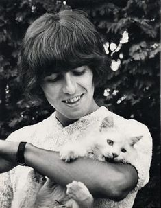 George Harrison with his cat, Corky