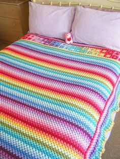 Love this variation of the granny stripe afghan. She put two rows of squares at the top and also went all the way around the afghan with twelve more rows. Wow!