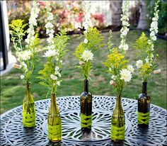 Kenneth. Wine Bottle Centerpieces that I will be using on the arms of the benches outside filled with real flowers from my garden.