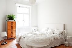 White Bedroom with Wooden Floors