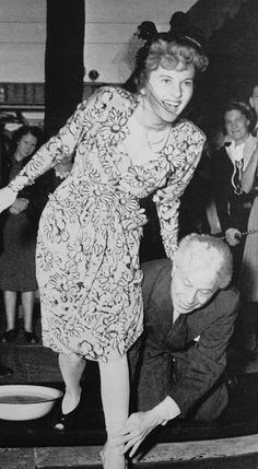 Joan Fontaine leaving her footprints at Grauman's Chinese Theatre