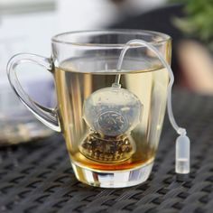 this is so cute and cool! mini tea diver/tea strainer. I want it!  A+R Store!