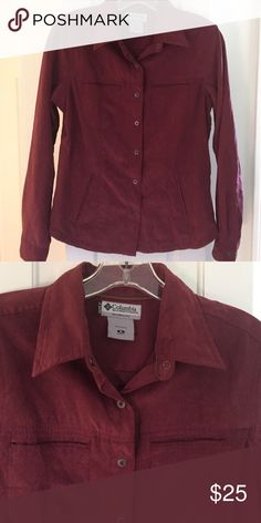Columbia maroon shirt/jacket Polyester maroon jacket/ shirt (but feels a bit like suade). Snap buttons with snaps also on the sleeves. Fitted shape with pockets and lined in nylon Columbia Jackets & Coats