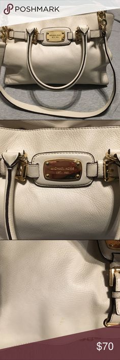 Authentic Michael Kors handbag🌟 Large Michael Kors handbag, used for a few months. The straps do have spots from using it. Beautiful bag, I always get tons of compliments when using it. It also has removable shoulder straps. If interested I'd be happy to send more photos. The inside has several pockets and zipper compartments for storage.   The photos do not do this bag any justice. Price is negotiable 😍 Michael Kors Bags Shoulder Bags
