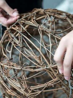 Make illuminated grapevine spheres to light up your summer patio.