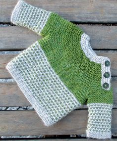 Free Knitting Pattern for Oslo Baby Sweater -Long-sleeved baby pullover is knit with garter stitch and easy slip stitch colorwork (one color per row). Buttons on shoulders for easy dressing. Size 0 – 3 months. Designed by kiddiwinksknits.