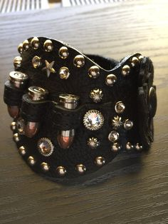 """Swarovski Crystals, Metal Studs, Leather Flower and Ammo Casings  Beautiful Tooled Leather   Adjustable two snap closure   Will fit a 7 1/4"""" to 8"""" wrist   Genuine Leather   Handcrafted in Anderson, Missouri   Classy Cowgirl Co- Gypsy Cowgirl ,Fun & Funky Western clothing, jewelry, & Accessories by Lane Boots, Junk Gypsy, R. Cinco Ranch,Hooey, Vocal, Ali Dee, Pink Panache, ATX Mafia, Urban Mangoz, Montana West, L&B, Beaver Soap, Crazy Train, cowgirl tu..."""