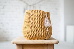 Cozy boho knitted mustard basket with linen tassel