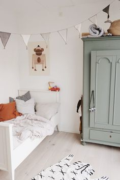 Modern farmhouse boy's room design featuring a green painted armoire, a white wood bed, woven illustrated animal rug, and gray and white banner garland - Unique Nursery Ideas & Children's Room Decor room ideas Decor Room, Bedroom Decor, Home Decor, Bedroom Ideas, Bedroom Lighting, Kids Room Lighting, Bedroom Curtains, Playroom Decor, Bedroom Colors