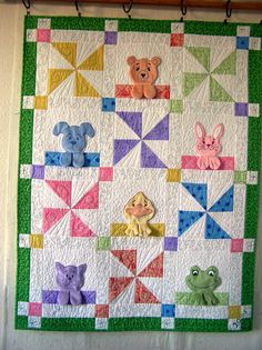 the little paws are so cute! also, if you look closely, the quilting under each animal says what it is. cute!