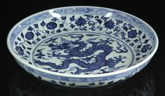 "Chinese Ming-style plate, blue and white porcelain, decorated with dragon motif, ruyi cloud and flower decoration, 13"" dia."