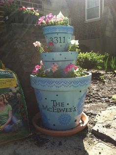 Stacked flower pots for the front of the house! :)