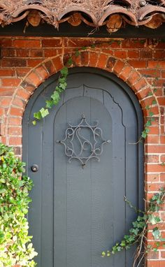 Arched grey door, Alameda, California