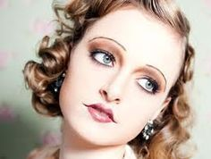 Like this girls softer version of 20s/30's makeup.AND since I have virtually no eyebrows to speak of I could totally recreate this!