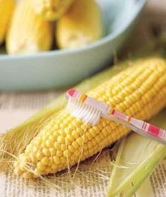 Toothbrush as Corn Cleaner  Use a clean toothbrush to remove stray threads of silk from freshly shucked ears of corn. The bristles will lift them away quickly and efficiently.