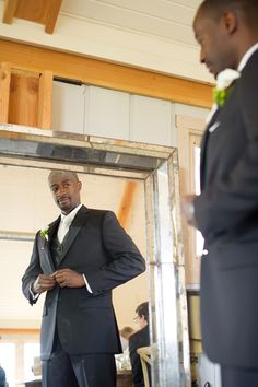 You always see photos of the bridesmaids getting ready, but don't forget about the groom and his guys! Even though their wedding prep may not be as, ahem, extensive as the girls', your photographer may still want to sneak in a few key shots, like this one.Related: Beyond the Black Tux: Stylish Groom Inspiration