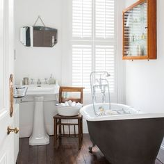 White bathroom with dark floorboards | Traditional bathroom design ideas | Bathroom | PHOTO GALLERY | Housetohome.co.uk