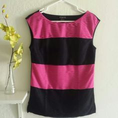 Ann Taylor color block sleeveless shirt Ann Taylor color block pink navy blue(dark blue)/ looks more like black sleeveless shirt.  Very versatile in design 100% polyester front,  95% cotton 5% spandex back, fully lined with 100% polyester.  Size S  Note brown shorts also available in my closet.  5% towards bundle discount. Or make me offer by hitting the offer button. Thank you. Ann Taylor Tops