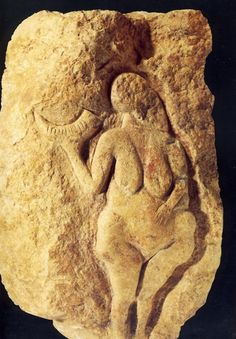 Carved Female figure holding horn from Laussel, France 20,000 BC....20,000 BC