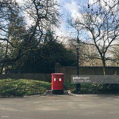 ストックフォト : Red Mailbox At Roadside Amidst Plants
