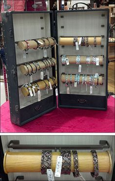 How about installing paper towel holders inside a suitcase. But glue or screw the central mandrel permanately. Add bracelets before going to fair. Awesome site featuring jewelry displays