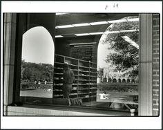 Student looking at journals inside Fondren Library, 1975