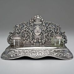 English, 19th century ornate Sterling Silver and Crystal Desk Standish, with two crystal inkwells on raised repoussé platform.: