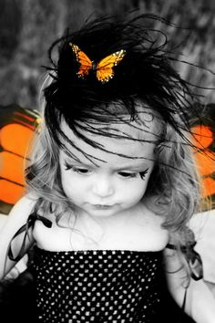 I love this pic of a little girl on Halloween! Black and white plus color is awesome!