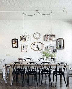 black bistro chairs - hanging pendants - rustic table - brick wall - pressed tin ceiling - vintage mirrors