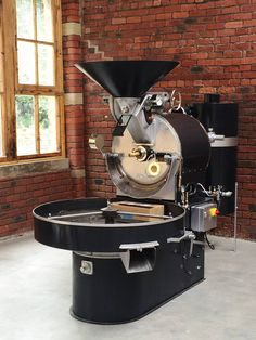After months of work, our beautiful old Probat UG22 coffee roaster is transformed in to a better-than original condition and installed in the mill