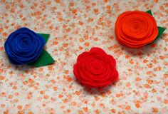 scalloped and rolled felt flowers (make to put on headbands)