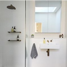 White vanity with exposed brass pipes, brass tap and mixer, brass rain fall shower head and clear glass shower screen. Project by - @thelittledesigncorner #taps #interiordesign #bathroom #australia #architecture #bathroomdesign #bathroomcollective Visit our website for more www.bathroomcollective.com.au